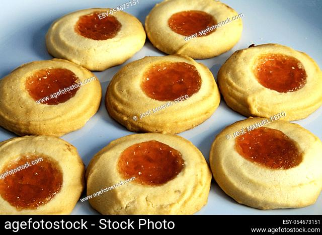 delicious tea pastes close-up on blue background