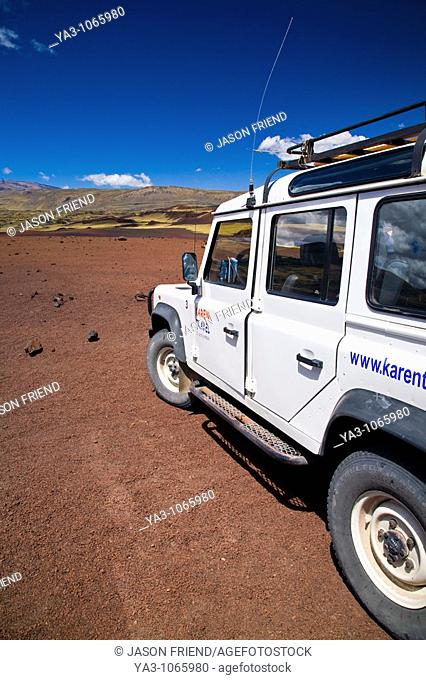Argentina, Mendoza, Parque Provincial Payunia  Tourist sight seeing 4 wheel drive jeep used to explore the reserve