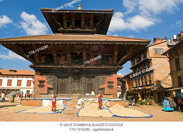 threshing rice in front of the Pashupatinath Temple in Durbar Square in ancient Bhaktapur, near Kathmandu, Nepal