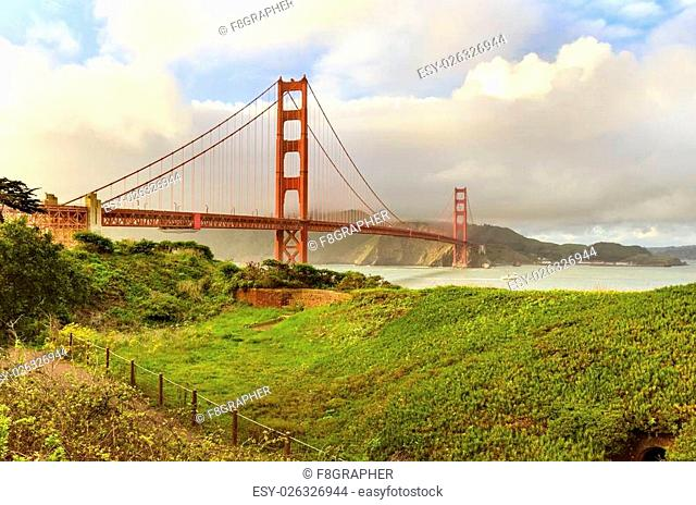 The famous San Francisco Golden Gate Bridge in California, United States of America. A view of the Bay and the red suspended bridge connecting Frisco to Marin...