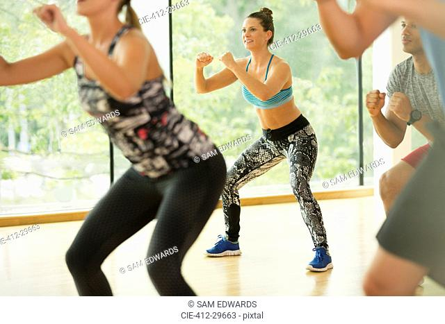 Smiling woman enjoying aerobics class