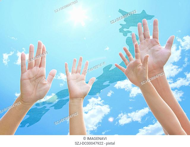 Japanese Archipelago and raised hands