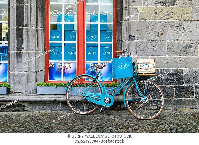 Promotional bicycle outside the 4711 cologne store in the centre of Brugge, Belgium
