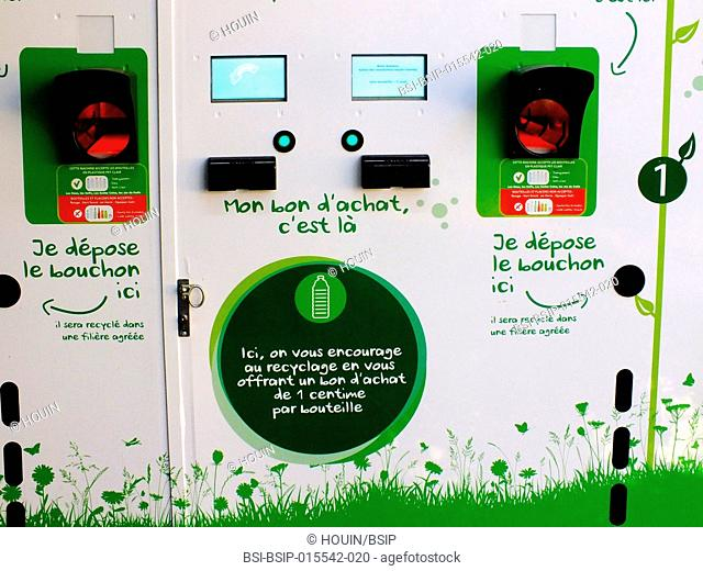 Automated plastic bottle recycler in a supermarket. There is a 1 centime (euro) voucher given for each bottle collected