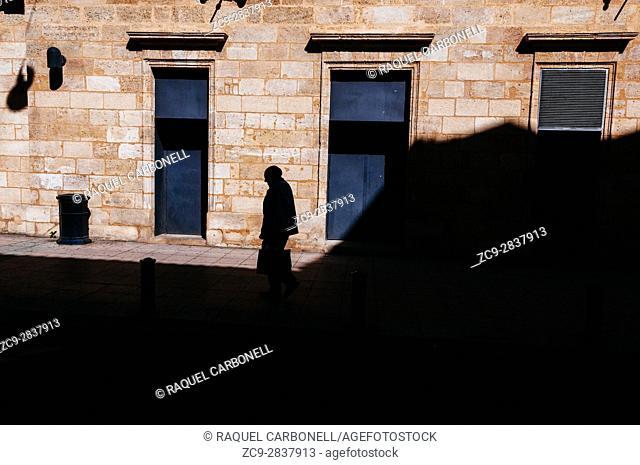 Elder man walking on the street, Bordeaux, France