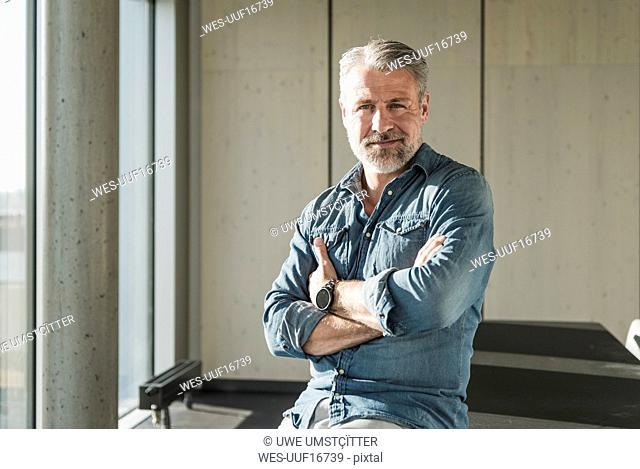 Portrait of confident casual mature businessman in office