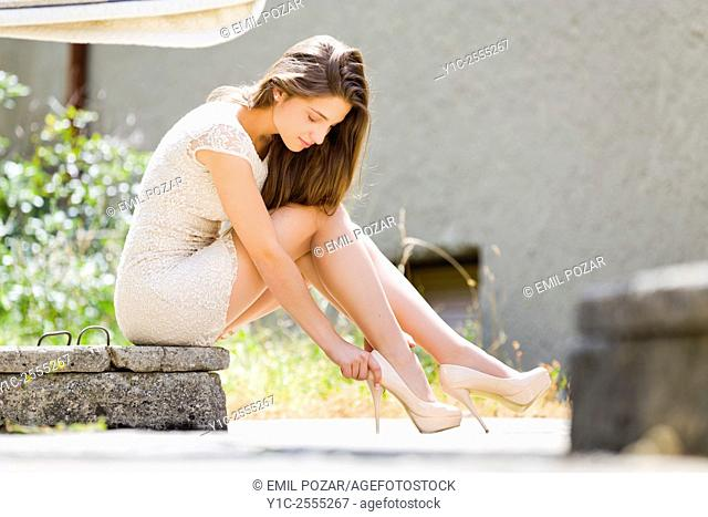 Beautiful young lady on high heels low view
