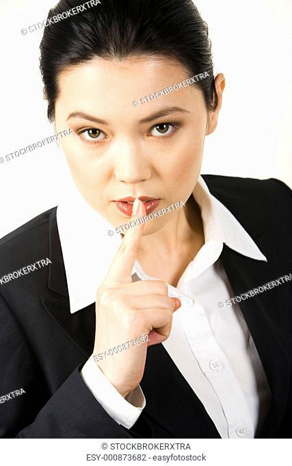 Portrait of responsible secretary showing sign - shhhh
