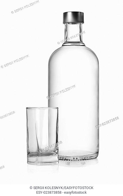 Bottle and glass of vodka isolated on a white background