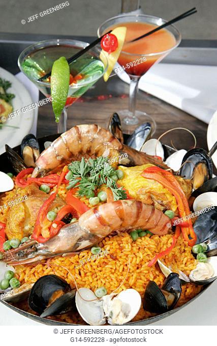 Florida, Miami Beach, Ocean Drive, food display, seafood, paella, rice, clams, drink