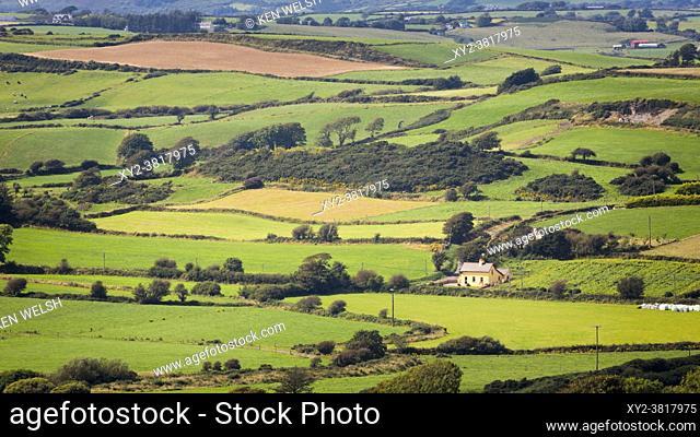 Typical landscape near Ardfield (or Ardfoyle), County Cork, Republic of Ireland. Eire. Farmland, farmhouses, chequered fields
