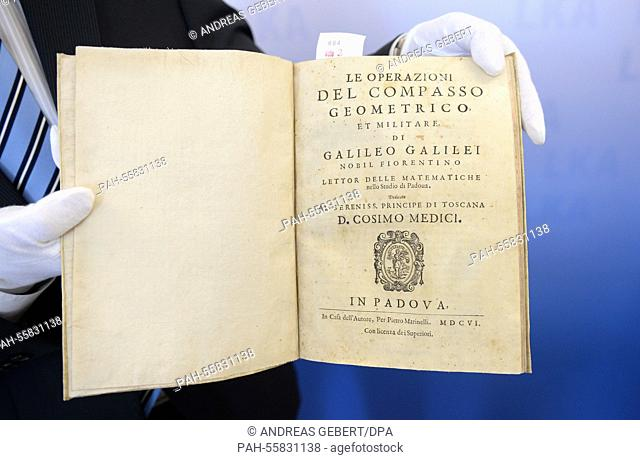 An employee of the Bavarian State Office of Criminal Investigations shows the book 'Le Operazioni Del Compasso Geometrico Et Militare'