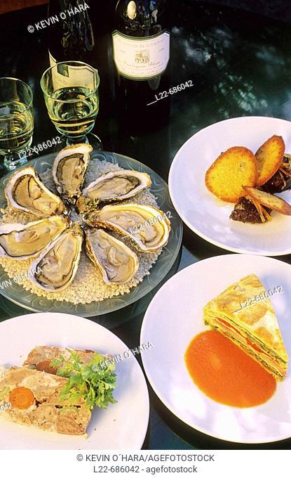 Specialities of restaurant 'Chez Philippe'. Bouzigues oysters, crespéou, pork terrine, chocolate fondant. Port of Marseillan. Hérault department