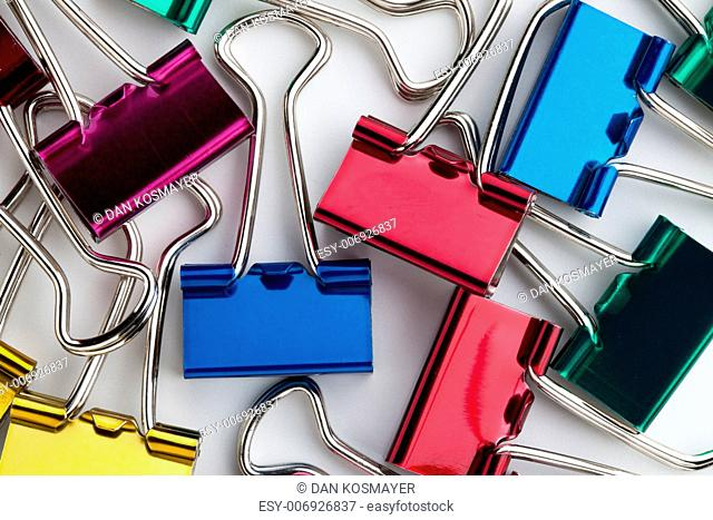 Close-up shot of shiny colorful paperclips
