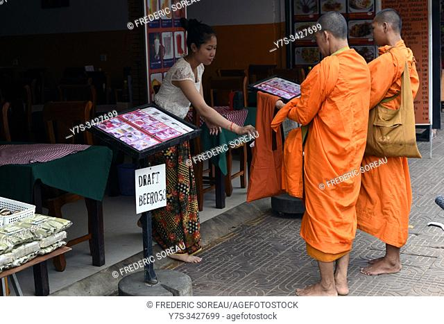 Buddhist monks on their morning alms round,Siem Reap ,Cambodia,South Esat Asia