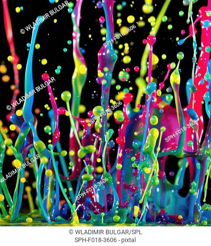 Multicoloured splashes against a black background