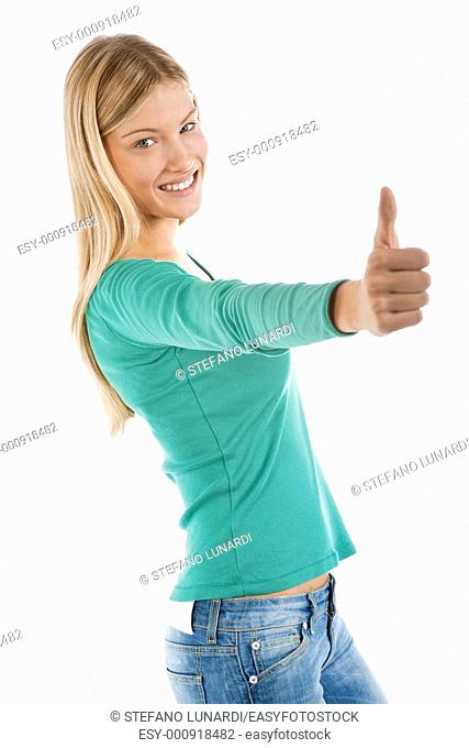 Beautiful teenage girl with thumbs-up, isolated on white