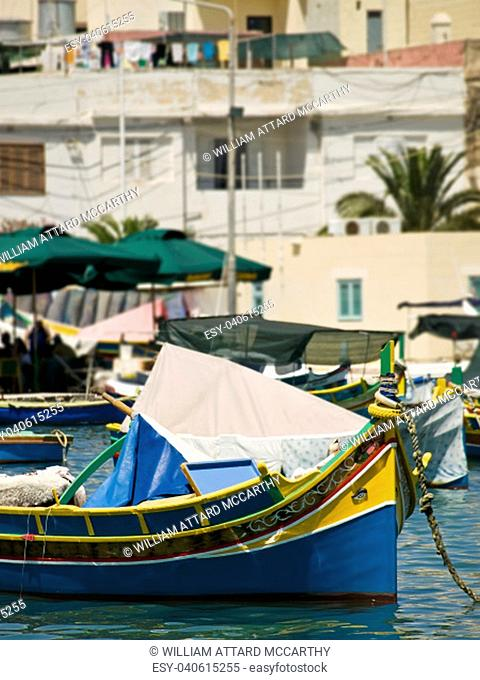 Traditional fishing boats of Malta in the fishing village of Marsaxlokk