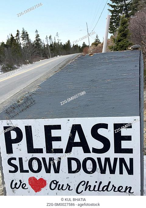 A polite sign requesting motorists to slow down as children are likely to be out and about in Halifax, NovaScotia, Canada