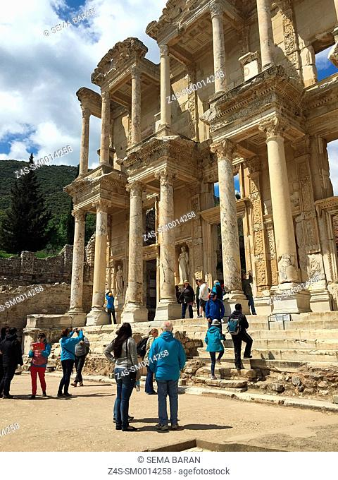 Tourists in front of the library of Celsus at the Roman ruins of Ephesus, Efes, Selcuk, Kusadasi, Turkey, Europe