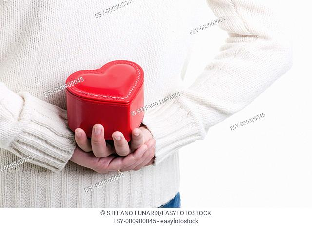 Man hiding a heart shaped box, Valentine's day, Christmas or Anniversary