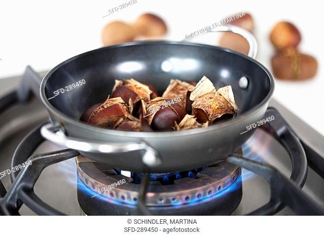 Chestnuts roasting on the hob
