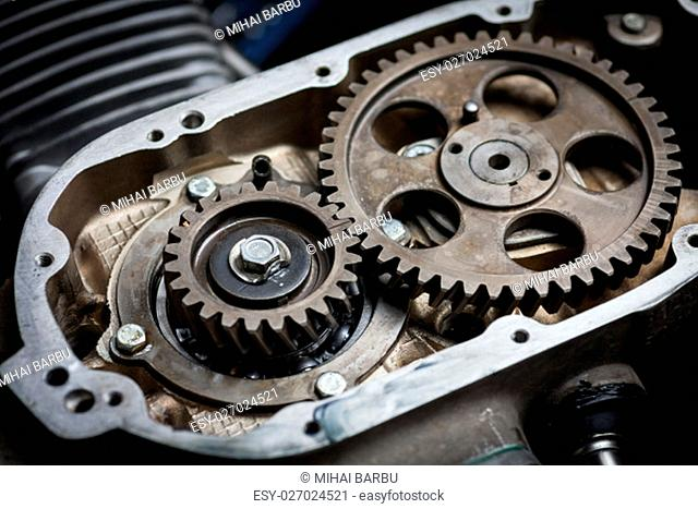 Close up shot the timing sprockets from a boxer motorcycle engine