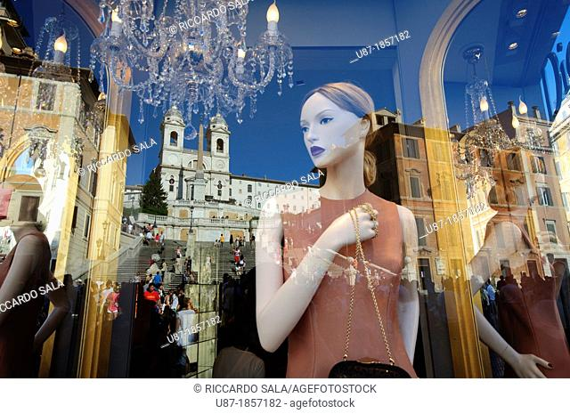 Italy, Lazio, Rome, Piazza di Spagna, Trinità dei Monti Church Reflected in the Window Shop Dior Boutique
