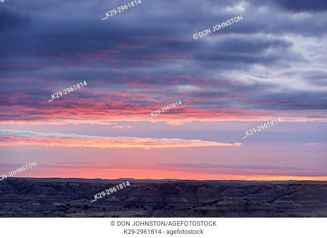 Sunset skies over the badlands from Buck Hill, Theodore Roosevelt NP (South Unit), North Dakota, USA