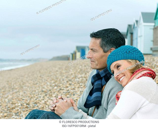 Couple huddled together on Beach