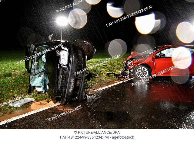 23 December 2018, Hessen, Neuberg: The wrecks of two cars are on the L 3195 after a collision. A young car driver under the influence of drugs caused a serious...