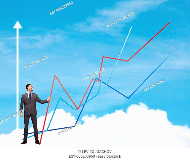 business, development and people concept - smiling man holding graph line over chart and blue sky background