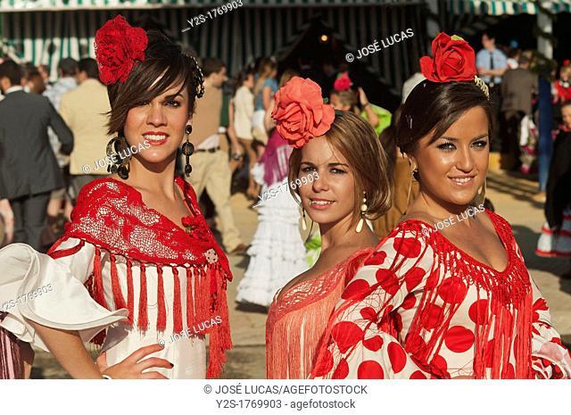 April Fair, Young women wearing a traditional flamenca dress, Seville, Spain