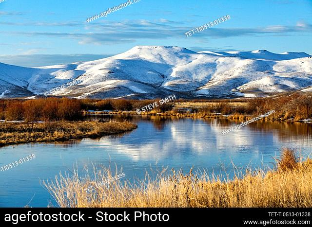 USA, Idaho, Sun Valley, Landscape with river and snowy mountains