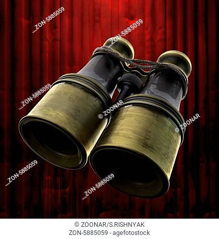 retro binocular and red curtain