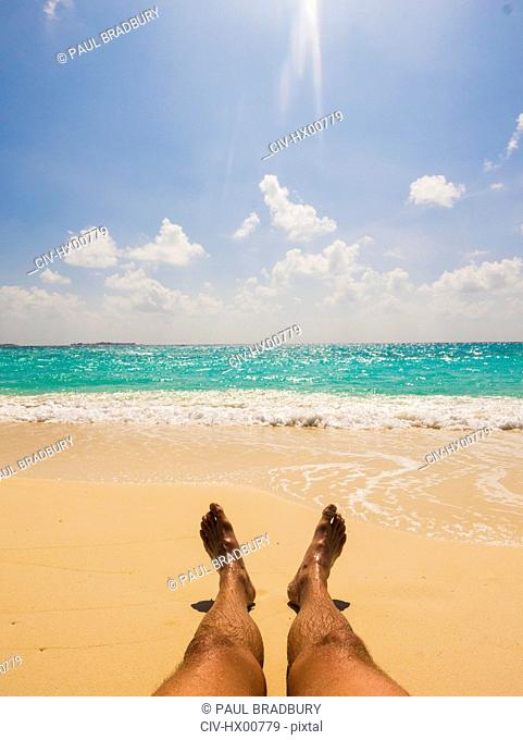 Man sunbathing on sunny tropical beach