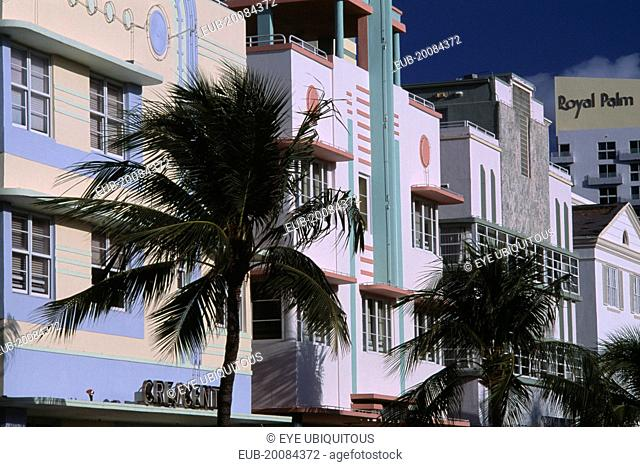 South Beach. Ocean Drive. Art Deco hotel facades and palm trees seen in early morning light