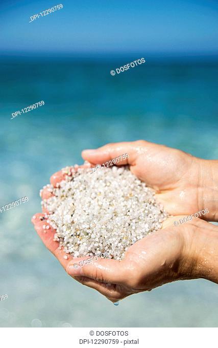 Grains of quartz in Mari Ermi beach, also known as the beach of the grains of rice; Oristano, Sardinia, Italy