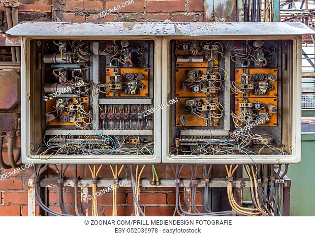weathered rusty old corroded open electric control cabinets