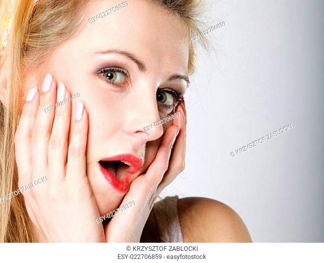 bright picture of surprised woman face over gray