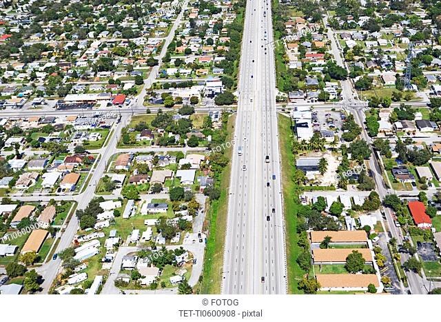 Aerial view of highway through residential area, Florida, United States