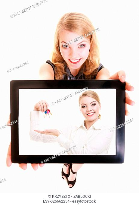 real estate agent businesswoman showing ipad with photo of woman with keys. happy blond girl holding a touchpad tablet dreaming about own home