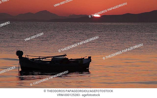 Boat on sunrise. Tyros, Arcadia, Peloponnese, Greece