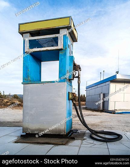 Vintage old gas pump on blue sky