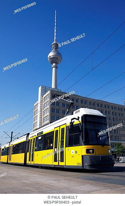 Germany, Berlin, Yellow tram, TV tower in background