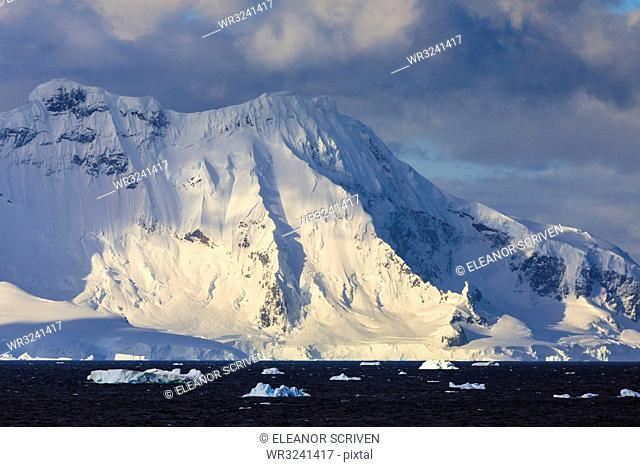 Gerlache Strait mountains, glaciers and icebergs, late evening before sunset, Antarctic Peninsula, Antarctica, Polar Regions