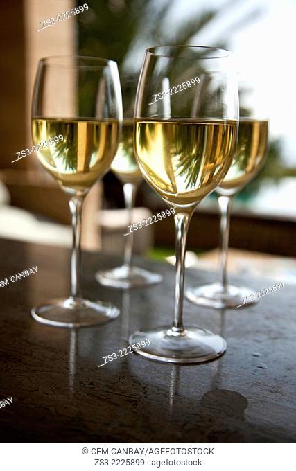 Close-up shot of glasses filled with white wine, Bodrum, Mugla, Aegean Sea, Turkish Riviera, Turkey, Europe