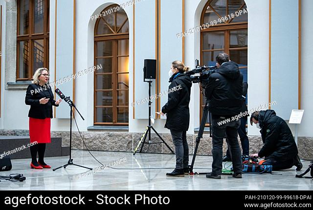 20 January 2021, Berlin: Svenja Schulze (SPD, l), Federal Minister for the Environment, is interviewed by a television crew after an online press conference on...