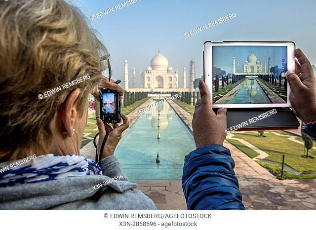 Tourists document their view of the Taj Mahal, located in Agra, India