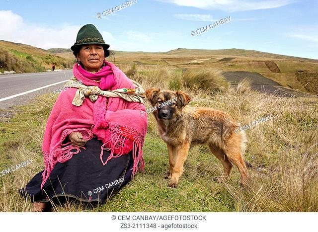 Indigenous woman with her dog on the countryside, Quilotoa, Central Highlands, Ecuador, South America